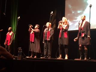 Abel Gyan and his colleagues singing in the CincySings finals.