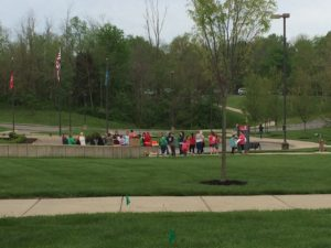 UC Clermont students and staff getting ready to welcome the buses of elementary students.