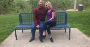 Cassandra Booe and her husband, Kyle Booe sitting together outside of UC Clermont's student lounge.