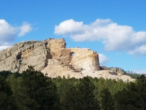 Statue of Crazy Horse, Sioux warrior under Sitting Bull on horseback, being carved in granite.