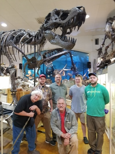 Research students with Peter Larsen founder of the Black Hills Institute in their museum.