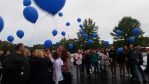 Those affected by suicide release balloons in memory of their loved ones,